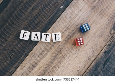 """dice on wooden table with alphabet """"FATE"""". lifestyle concept"""