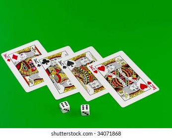 The dice and playing cards on green broadcloth (background).