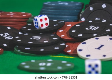 Dice ,Poker Chips Multicolor with a green background