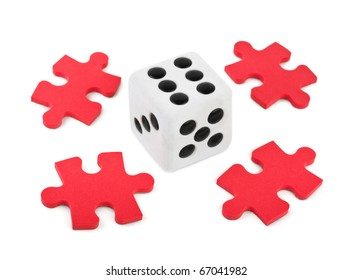 Dice and puzzle isolated on white background