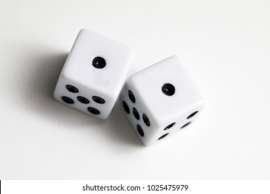 Dice shot up close on a white background, ones