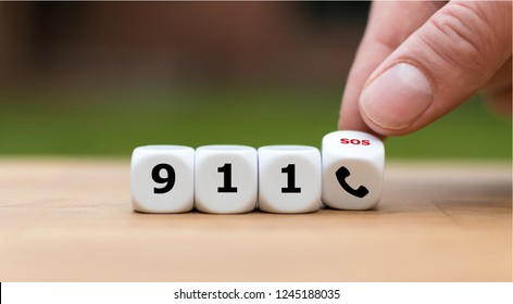 Dice show the emergency phone number
