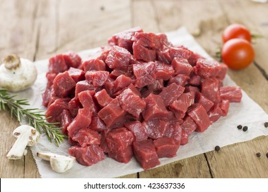 Diced beef on wooden background with space