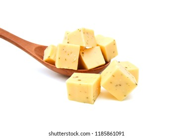 Diced blue cheese - studio shot in wooden spoon on white background