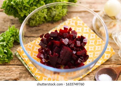 Diced boiled beets in a glass salad bowl