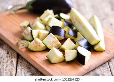 Diced eggplants on a wooden board