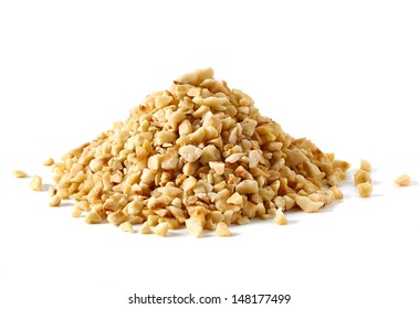Diced filberts or hazelnuts pile on white background