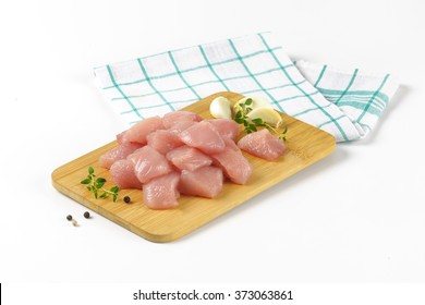 diced turkey breasts on wooden cutting board