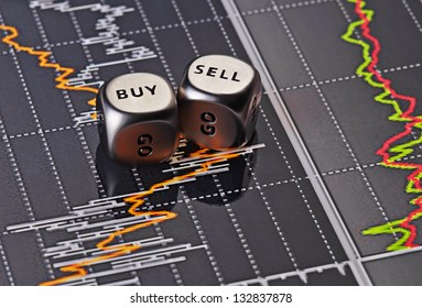 Dices cubes to trader. Cubes with the words SELL BUY on financial chart as background. Selective focus