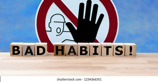 """Dices form the words """"BAD HABITS"""" infront of a stop sign"""