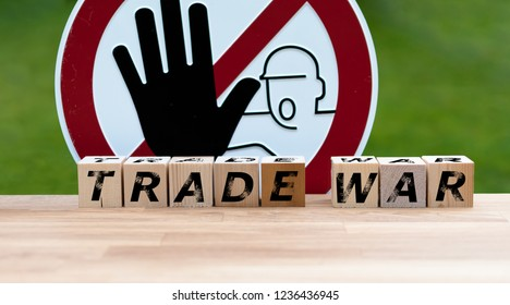 """Dices form the words """"TRADE WAR"""" infront of a stop sign"""