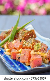 Dices fresh ahi tuna with onions and sprinkled with furikake seasoning
