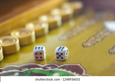 Dices set.Play backgammon table game.Rolling dice in old board game