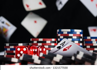 dices and two ace cards surrounded by poker chips background of falling cards