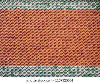 Dichromatic brick roof tiles on roof of a country house of Thailand