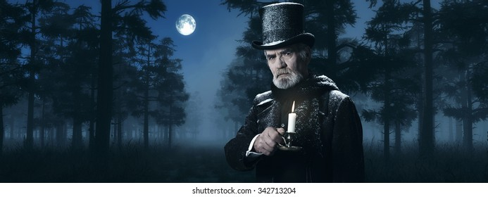 Dickens Scrooge Man with Candlestick in Foggy Winter Forest at Moonlight.