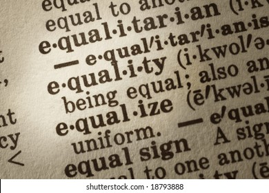 """Dictionary definition of """"equality"""".  Close-up view, showing paper textures."""