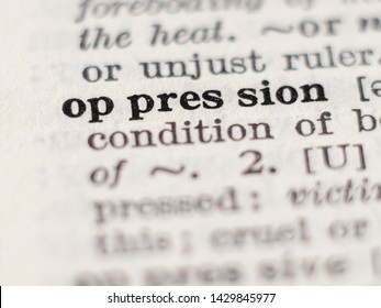 Dictionary definition of word oppression, selective focus.