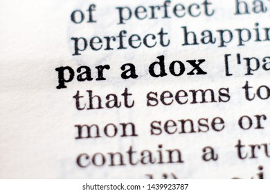 Dictionary definition of word Paradox, selective focus.