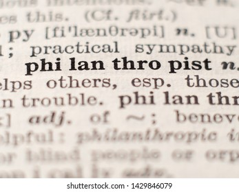 Dictionary definition of word philanthropist, selective focus.