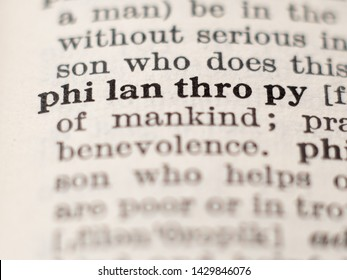 Dictionary definition of word philanthropy, selective focus.