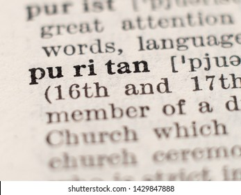 Dictionary definition of word puritan, selective focus.