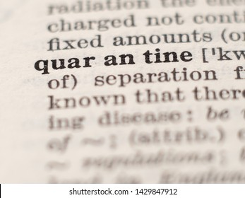 Dictionary definition of word quarantine, selective focus.