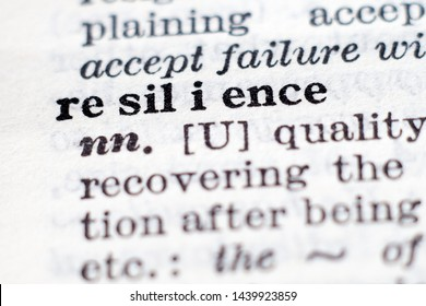 Dictionary definition of word Resilience, selective focus. Perseverance, adaptation and dealing with failure concept.