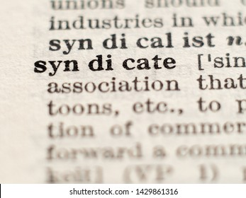 Dictionary definition of word syndicate, selective focus.