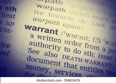 Dictionary definition of the word Warrant . Toned Image