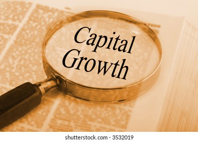 Dictionary with magnifying glass emphasising the words Capital Growth. See others from this series in our portfolio.