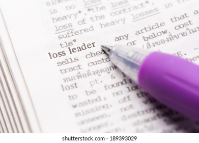 """Dictionary page with word """"loss leader"""" in focus."""