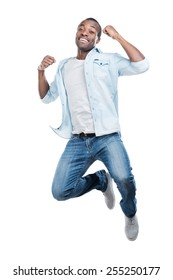 I did it! Full length of handsome young black man jumping against white background