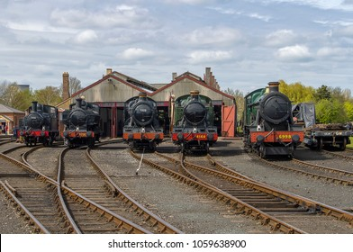 DIDCOT, OXFORDSHIRE, UK - MAY 1, 2016: A view across the rail yard, and a lineup of Great Western Railway locomotives, at the Didcot Rail Centre during their Steam Gala.