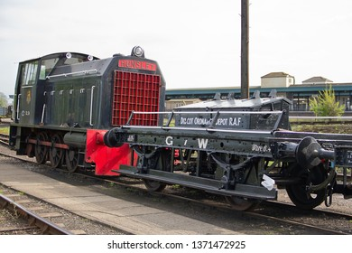 DIDCOT, OXFORDSHIRE, UK - MAY 4, 2014: Hunslet 0-6-0DM No. DL26 coupled with an M4 Shunter's Truck, on display at the Didcot Railway Centre during the Great Western & Metropolitan Railways Steam Gala.