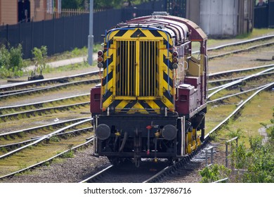 DIDCOT, OXFORDSHIRE, UK - MAY 4, 2014: EWS-liveried shunter, Class 08 0-6-0DE No. 08879, stands idle in the sidings near Didcot Parkway Station.