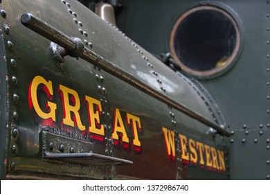 DIDCOT, OXFORDSHIRE, UK - MAY 4, 2014: A portrait shot of the saddle tank and Great Western wording, on GWR steam locomotive 0-4-0ST No. 1340 'Trojan', at Didcot Railway Centre.