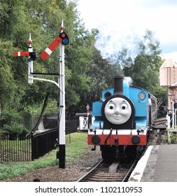 DIDCOT, OXFORDSHIRE, UK - OCTOBER 5, 2013. Thomas the Tank Engine is a live steam engine character, based on the books by Reverend Wilbert Awdry, running at Didcot Railway Centre, Oxfordshire, UK.