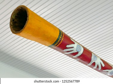 Didgeridoo hanging under a white ceiling