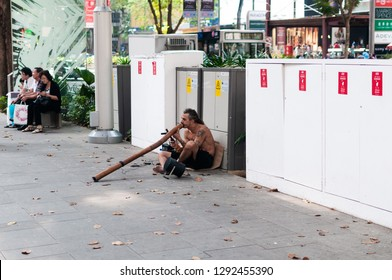 A didgeridoo player along Orchard Road in Singapore, June 12, 2010