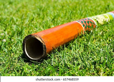 Didgeridoo - traditional aboriginal music instrument - on the grass