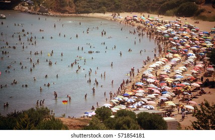 DIDIM, TURKEY - JULY 9, 2014. Beach with tourists, a top view.