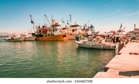 Didim, Turkey - October 03, 2017: Several commercial fishing boats in town harbor in Didim, Turkey