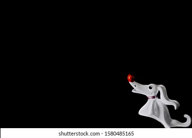A die cast model of the Ghost Dog Zero.  Isolated in black and room for text