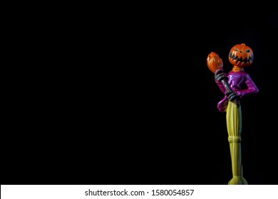 A die cast model of Jack Skeleton from the Nightmare Before Christmas. Isolated in black and room for text.