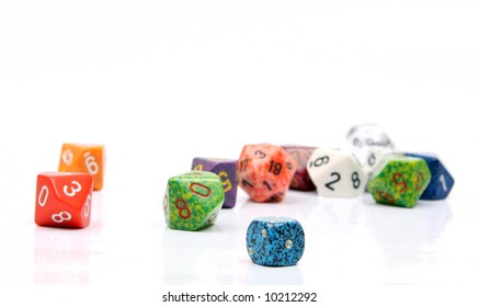 Die, or dice commonly used in board and role-playing games. Shown here a number of ten sided dice (d10) and six sided dice (d6) along side a twenty sided die (d20)