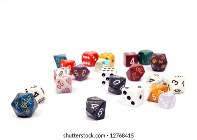 Die, or dice commonly used in board and role-playing games. Shown here a number of ten sided (d10), six sided (d6), twenty sided (d20) and other assorted shapes and sizes.