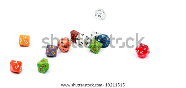 Die, or dice commonly used in board and role-playing games. Shown here a number of ten sided dice (d10) and six sided dice (d6)