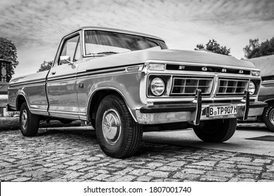 """DIEDERSDORF, GERMANY - AUGUST 30, 2020: The full-size pickup truck Ford F-150 Ranger XLT, 1979. Black and white. The exhibition of """"US Car Classics""""."""