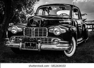"""DIEDERSDORF, GERMANY - AUGUST 30, 2020: The full-size car Lincoln coupe (H-series), 1946. Black and white. The exhibition of """"US Car Classics""""."""